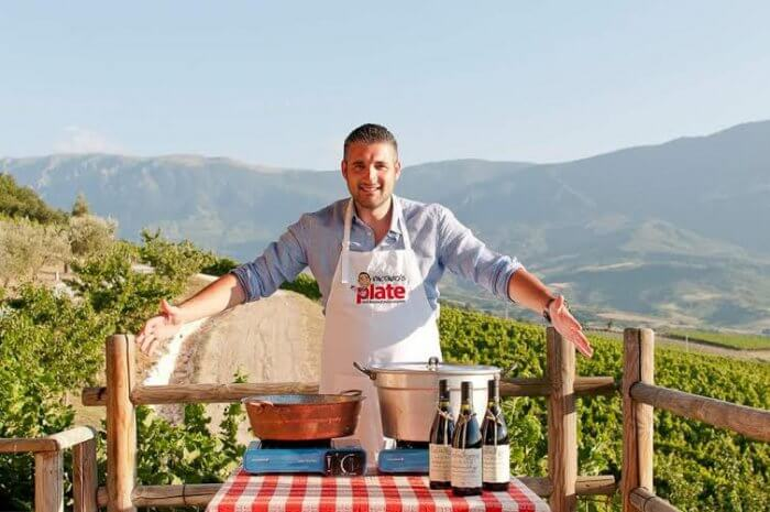 Italian chef Vincenzo at an Italian countryside showcasing his food on a table