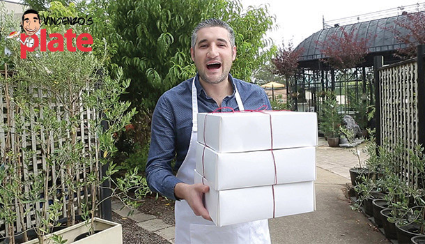 chef Vincenzo holding food containers in Bonnyrigg Garden Centre