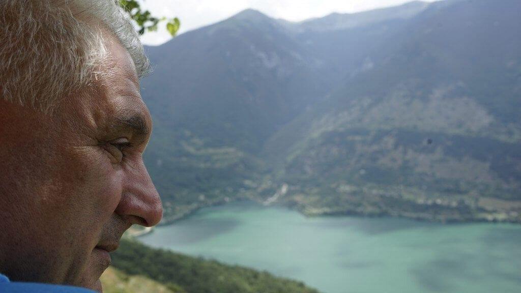 man looking towards the mountains in Abruzzo Italia