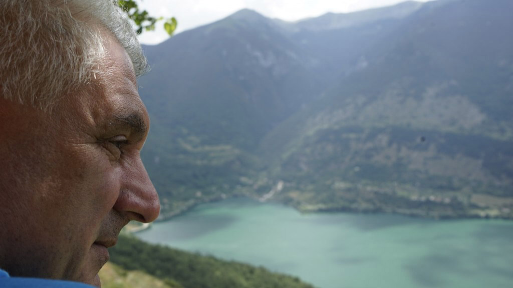 man looking towards the mountains in Abruzzo Italia