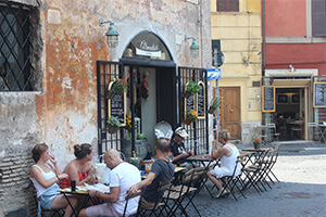tourists having a coffee outside Rome cafe