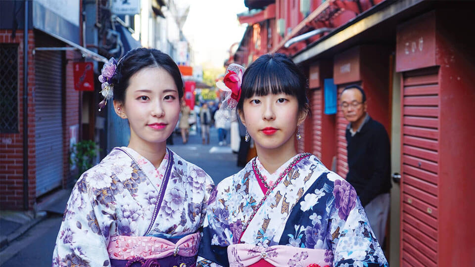 two Japanese woman wearing traditional Japanese outfits in Tokyo