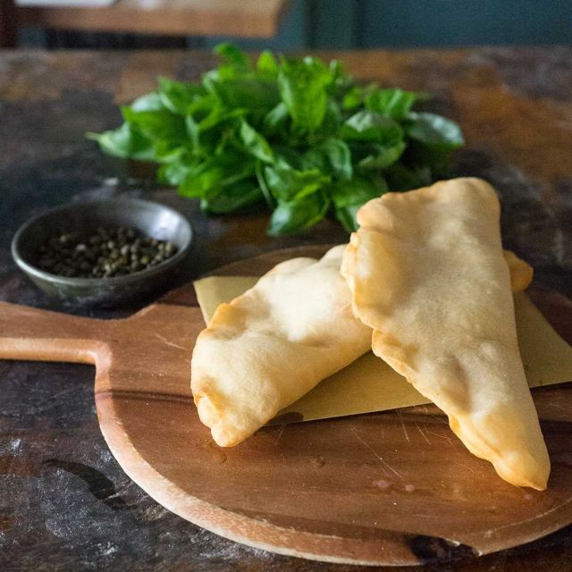 """PANZEROTTI RECIPE #Panzerotti are a delicious Italian deep fried snack made from a special pizza-like dough and stuffed with a variety of fillings. These crispy panzerotti are stuffed with gooey #mozzarella, freshly crushed #tomatoes and #capers. You will not be able to resist (or stop at one). 🤤  👨🏻🍳 To get the #recipe GOOGLE """"Panzerotti Vincenzo's Plate"""" orf ollow the link -> https://www.vincenzosplate.com/recipe-items/panzerotti/ . . . #panzerottifritti #deppfried #italianpanzerotti #friedpanzerotti #italianrecipe #pugliafood #italianfood #vincenzosplateinitaly"""
